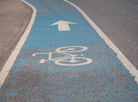 Bicycle symbol on asphalt bike lane. Bicycle path on street.