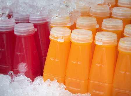 Orange juices and beetroot juices in ready-to-drink plastic bottles.