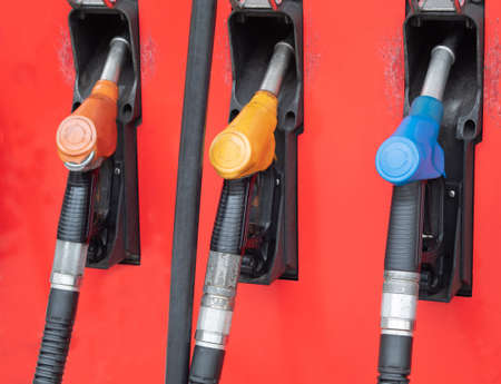 Various types of Car fuel dispensers installed in gas stations.