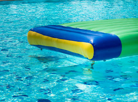 Colorful rubber rafts floating in the swimming pool. Standard-Bild