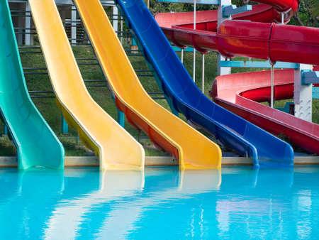 Colorful plastic water-slide in swimming pool or water park.
