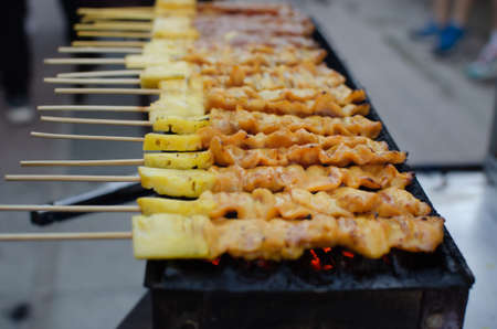Barbecue pork or beef skewers are grilled over charcoal sold on street food.