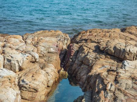 Beautiful natural rocks beach and turquoise sea waves. Standard-Bild