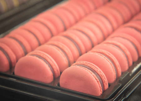 Sweet Pink Almond Macarons or French sweet cookie.