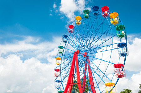 Giant ferris wheel against blue sky and white cloud