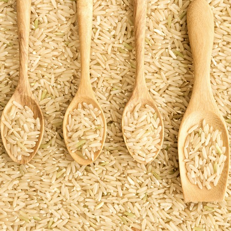 Jasmine rice in wooden spoon photo