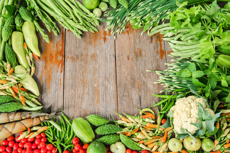 Group of tropical vegetables frame on plank