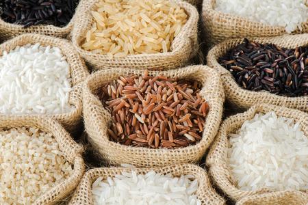 jasmine: Group of organics rice in burlap bag Stock Photo