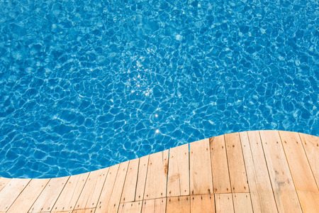 Blue swimming pool with a plank curve