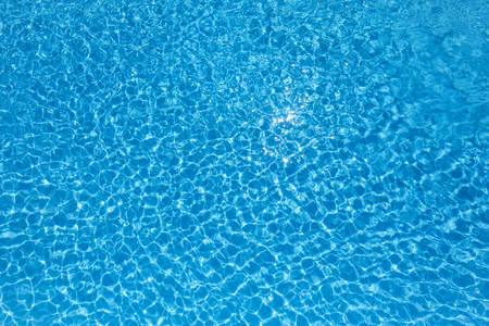 Blue water rippled background in swimming pool 免版税图像