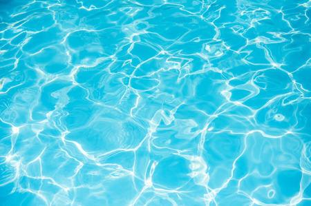 Blue water rippled background in swimming pool Banco de Imagens