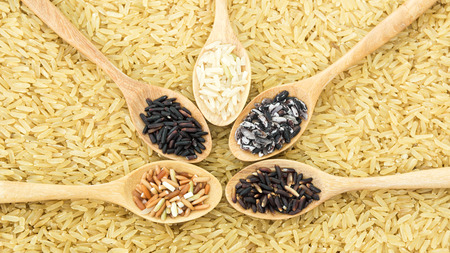 organics: Organics rice on wooden spoon