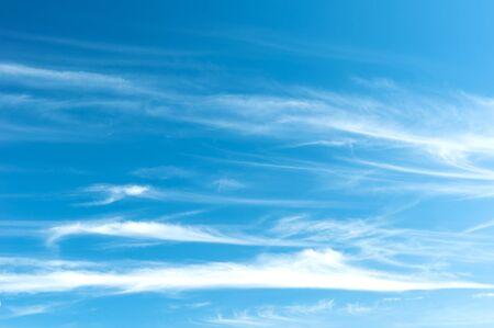 nebulosity: Fluffy clouds on blue sky Stock Photo