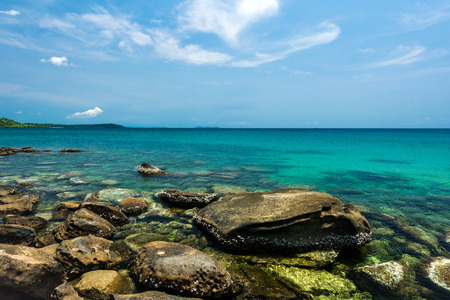 sky: Stone beach landscape with blue sea Stock Photo