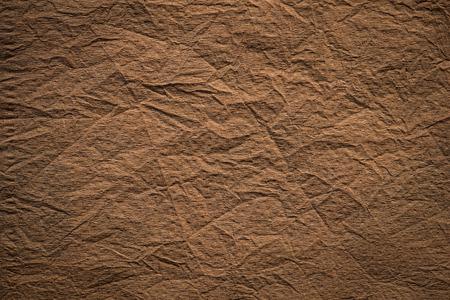 vintage paper: Brown paper textured  in dark tone Stock Photo