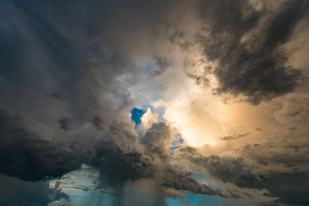 dark skies: Dark storm clouds and rainy Stock Photo
