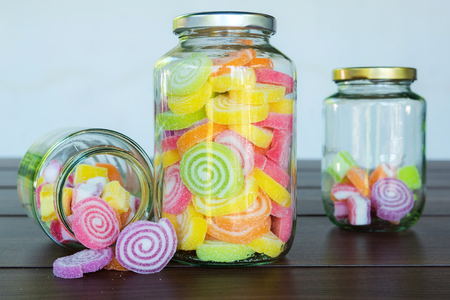 multi colour: Multi colour candies displayed in glass jars Stock Photo