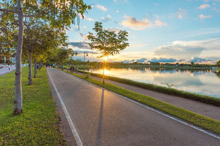 Jogging track with lake's landscape in the morning