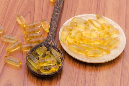 omega3: Fish oil omega3 with wooden spoon Stock Photo