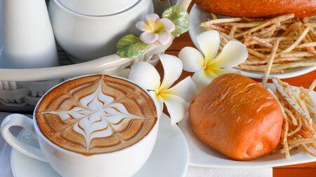 serv: coffee with sweet bun for breakfast
