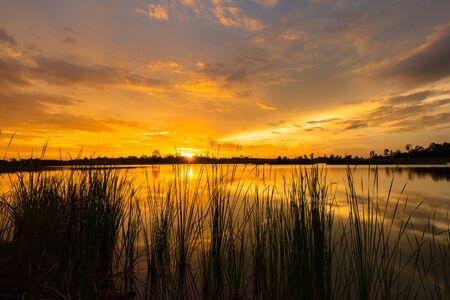 eventide: Sunset landscape over the calm lake Stock Photo