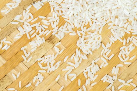 organics: Jasmine rice on the bamboo woven backgrond