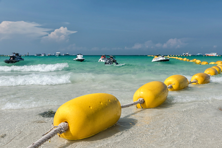 Yellow buoy at the Pattaya beach in Thailand