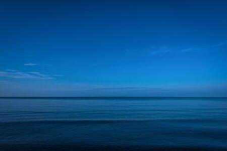 dark skies: Calm ocean in twilight Stock Photo