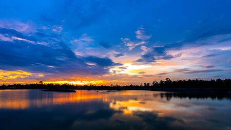 Breathtaking sunset over the lake at Udonthani province ,Thailand Stock Photo