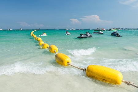 beach buoy: Yellow buoy at the Pattaya beach in Thailand