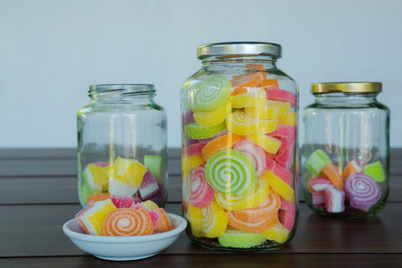glass jars: Multi colour Candies displayed in glass jars Stock Photo