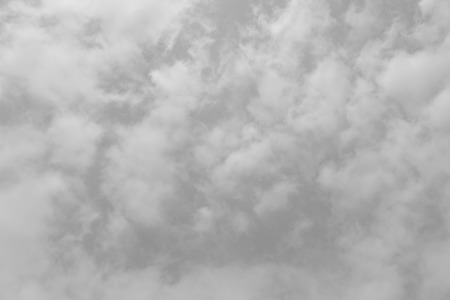 glowering: Abstract gray background composed of indistinct cloud shapes