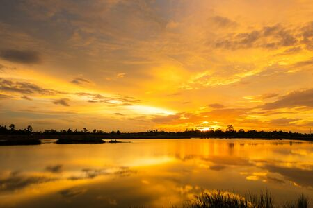 eventide: Sunset with Golden light over the lake