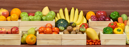 Fresh fruits and vegetables in wooden box at the supermarket Standard-Bild