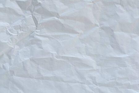 Zerknittertes weißes Papier texturiert