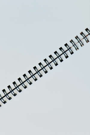 diagonal diary education: Vertical white page with diagonal black binder for background Stock Photo