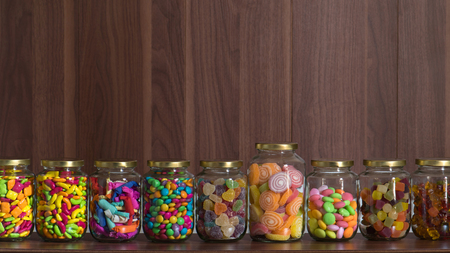 sugary: Various sugary candy in a class jar Stock Photo