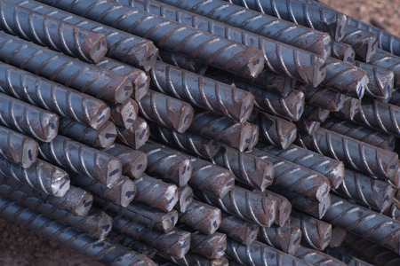 corode: Closeup the end of steel rods used in construction to reinforce concrete