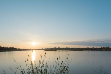 tranquility: Sunset landscape over the tranquil lake Stock Photo