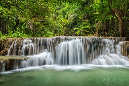 Green landscape with bright waterfall , Erawan waterfall , Loacated Karnjanaburi Province , Thailand