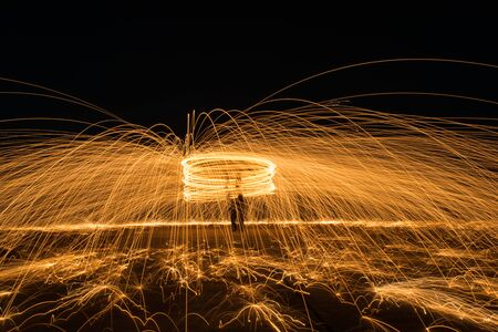 Spinning burning steelwool at night