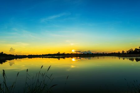 lake sunset: Sunset over the lake with blue sky Stock Photo
