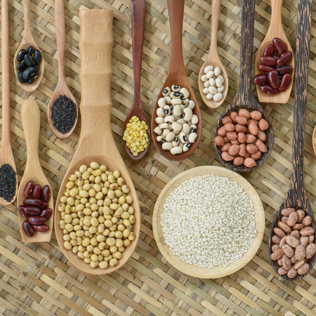 leguminous: Top view of various leguminous and white sesame with a wooden cookware, Flat lay