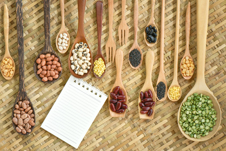 borlotti beans: Top view of various leguminous with a wooden cookware, Flat lay Stock Photo