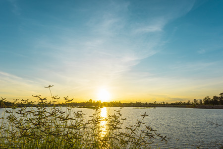 eventide: Sunset landscape over the lake with blue sky Stock Photo