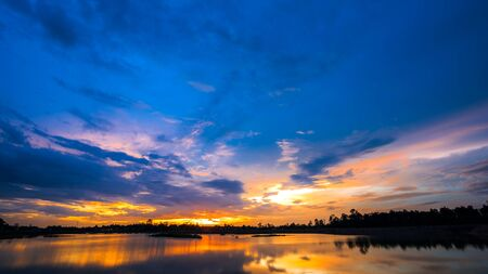 eventide: Beautiful sun set over lake with blue sky