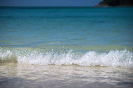 dept: Closeup water splash at tropical sea, Selective focus shallow dept of field