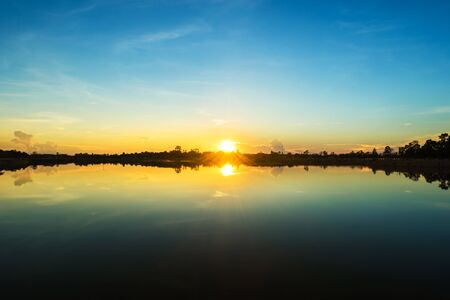 eventide: Sunset landscape with blue sky at the calm lake