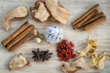 herbal background: Different ingredients for Chinese soup on wooden background and flat lay, Chinese herbal Ingredient for healthy concept