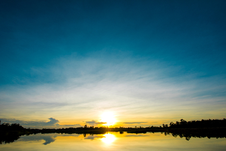 eventide: Beautiful sunset at the wetland, Breathtaking sunset with blue sky